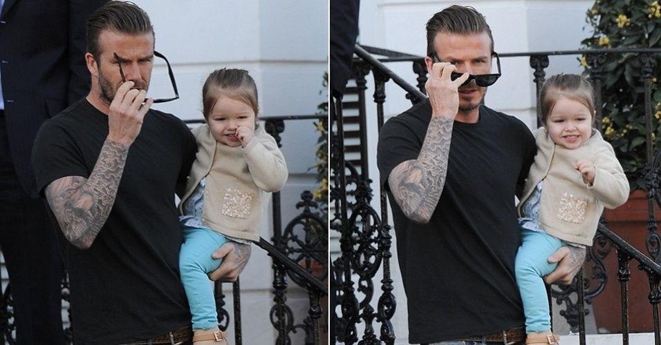 30.abr.2013 - O jogador ingls David Beckham aproveitou o dia de folga para curtir a pequena Harper. Elegantes, pai e filha foram flagrados durante passeio pelas ruas de Kensington, em Londres
