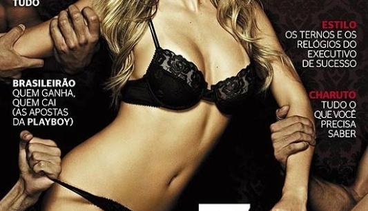 Agarrada por várias mãos, a ex-BBB Renata aparece de lingerie preta na capa da edição de maio da revista